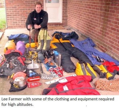 Lee Farmer with some of the clothing and equipment required for high altitudes1