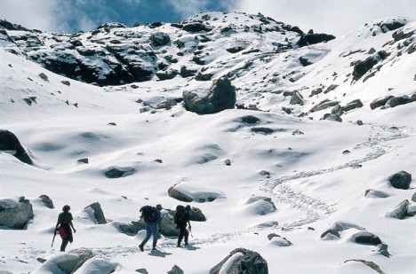 Trekkers walking on thick snow, Mera Peak
