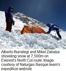 Alberto Iñurrategi and Mikel Zabalza shoveling snow at 7,500m on Everest's North Col route
